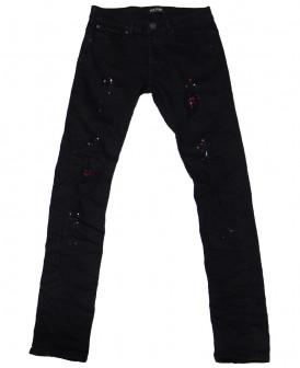 Jeans slim noir tacheté...